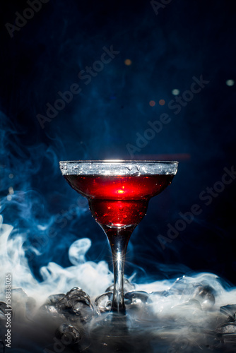 Fototapety, obrazy: red cocktail with ice vapor, blue background
