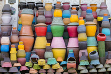 Colorful Clay Pots On The Grou...