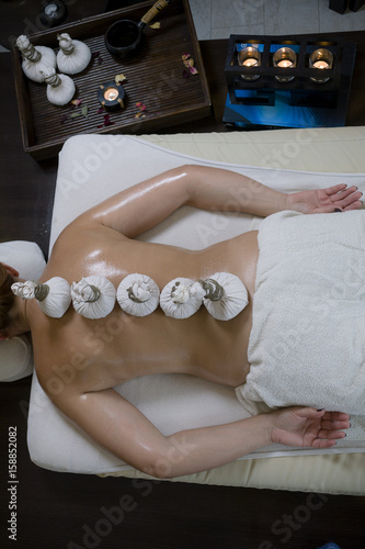 Fototapety, obrazy: Thai relax massage with scented oils and herbal bags