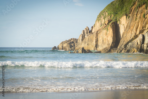фотография  Beautiful beach in the north of Spain, nature of Asturias in warm summer evening