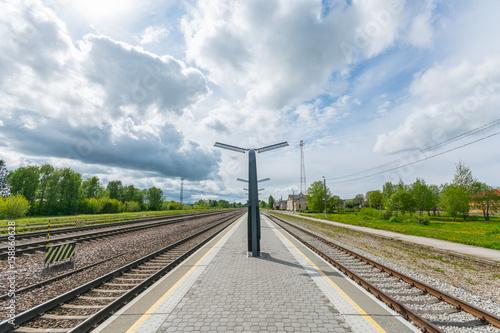 Empty train station. Summer landscape.
