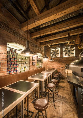 Photo Stands Library Wooden interior of restaurant with empty tables and bar stools
