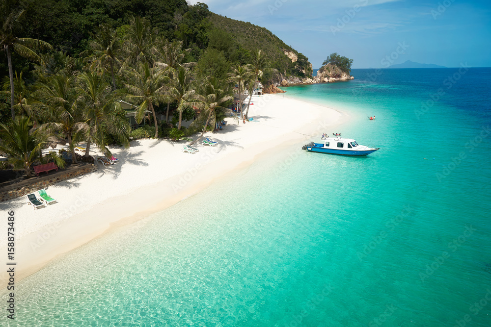 Fototapeta Beautiful beach aerial view over a Rawa island. White sandy beach seen from above. Malaysia .