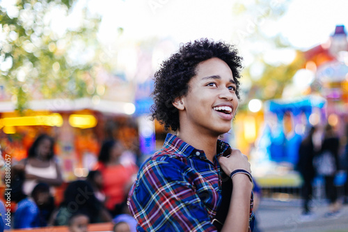 Papiers peints Attraction parc Portrait of teenage boy at funfair, smiling