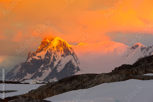 Glowing red mountains at sunset in Antarctica Canvas Print