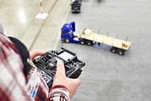 Man With Radio Remote Control And Truck Model