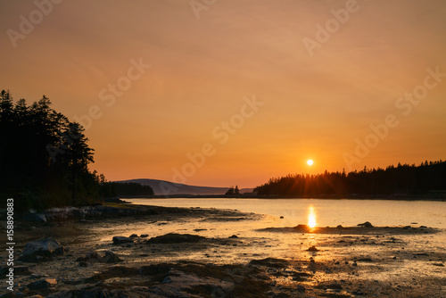 Fotografie, Obraz  Sunset over islands and water