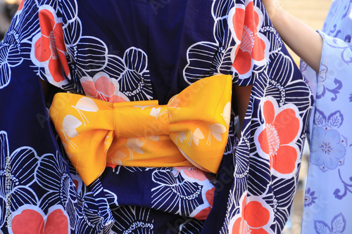 Flourish pattern kimono with yellow color banding sash in a bow shape Wallpaper Mural
