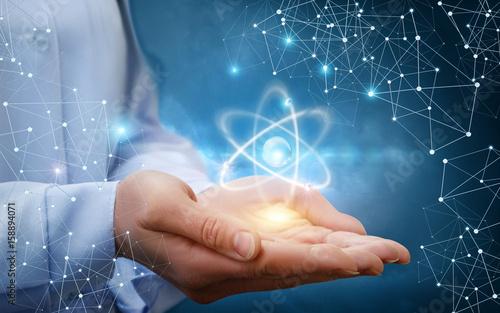 Atom molecule in female hands.