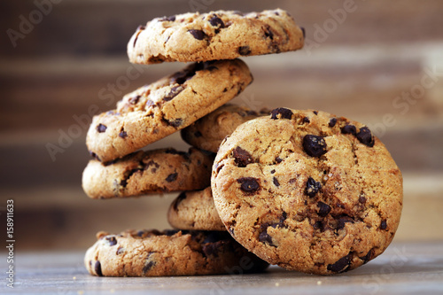 Foto op Aluminium Koekjes Chocolate cookies on wooden table. Chocolate chip cookies shot