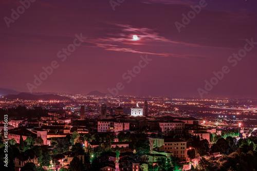 Poster Crimson View at Old Town Citta Alta of Bergamo from San Vigilio Hill. Bergamo, Italy. Night view.