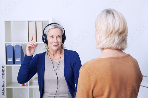 Senior woman undergoing a hearing test Canvas Print