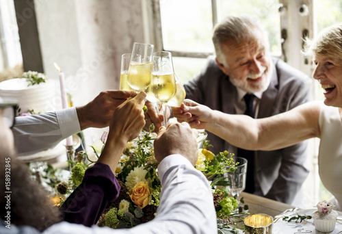 Fotografering  Group of Diverse People Clinking Wine Glasses Together Congratulations Celebrati