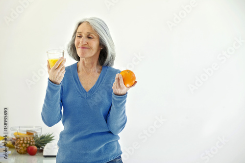 Fotografie, Obraz  Elderly person with cold drink