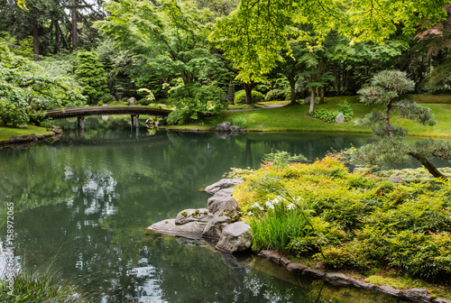 Fotografie, Obraz  Sculpted Japanese Garden Around Green Pond