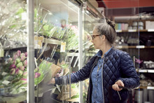 Mature Woman Buying Flowers Fr...