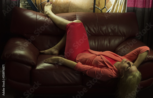 Foto op Canvas Paarden A young woman lying on the couch