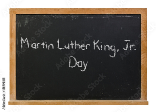 Photo  Martin Luther King, Jr day written in white chalk on a black chalkboard isolated