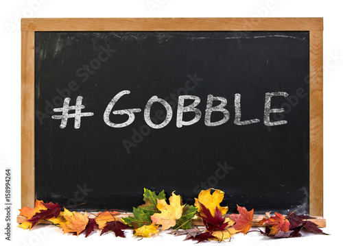 Valokuva  Hashtag gobble written in white chalk on a black chalkboard decorated with autum