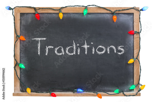 Fotografie, Obraz  Traditions written in white chalk on a black chalkboard surrounded with festive