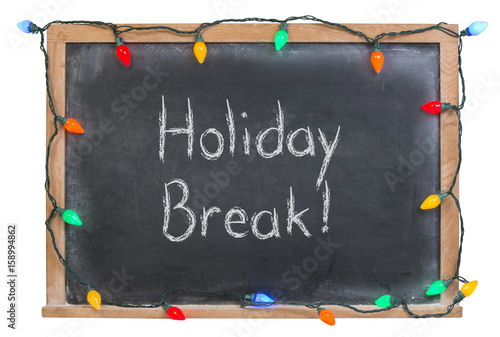 Fotografie, Obraz  Holiday break written in white chalk on a black chalkboard surrounded with festi
