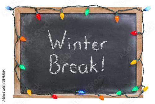 Valokuva Winter break written in white chalk on a black chalkboard surrounded with festiv