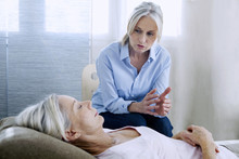 Senior Woman Undergoing Hypnosis Session