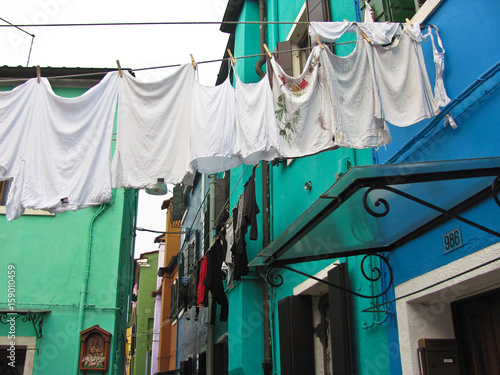 Fototapety, obrazy: Burano, near Venice, Italy. Bright colored houses and laundry hung up to dry