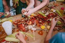 Friends Enjoying A Crab Feast ...