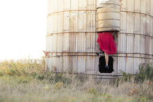 A Curious Girl Takes An Adventure Up An Abandoned Silo