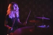 Confident Female Drummer Perfo...