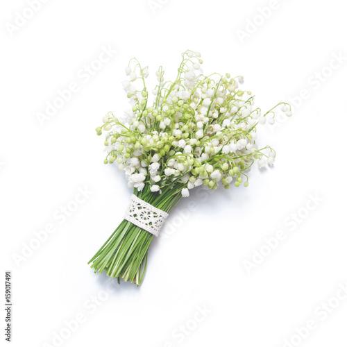 Staande foto Lelietje van dalen Bouquet of lilies of the valley on white background