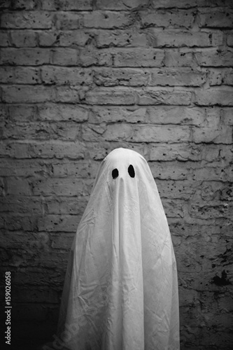 Little boy in halloween ghost costume