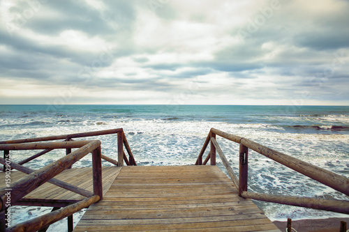 wooden foot bridge on the sea