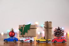 Christmas Gift Boxes On Four Different Toy Cars