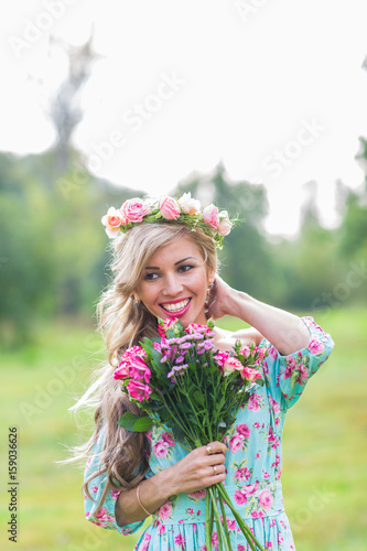 Canvas Prints Textures outdoor portrait of a beautiful blonde woman. attractive happy girl in a field with bouquet of flowers.