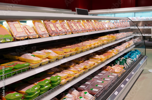 Fresh chicken meat on supermarket shelf