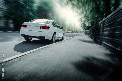 Spoed Foto op Canvas Stadion White car standing near high mountains at daytime