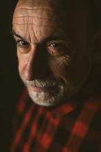 Portrait Of Old Man On Black Background