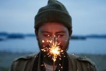 Young Man Holds Sparkler In Fr...