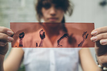 Young Woman Holding A Negative...