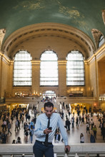 Businessman Using A Phone In Grand Central Station - New York