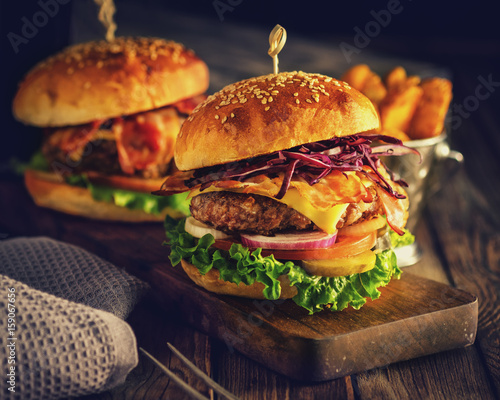 Delicious homemade hamburger on wooden background Fototapet
