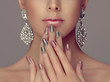 canvas print picture - Beautiful model girl with pink and gray  silver  metallic manicure on nails . Fashion makeup and cosmetics . Big silver diamond shine  earrings jewelry .