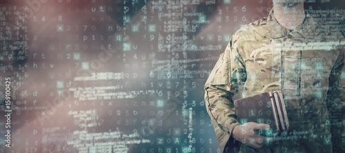Fotografiet Composite image of mid section of soldier holding books