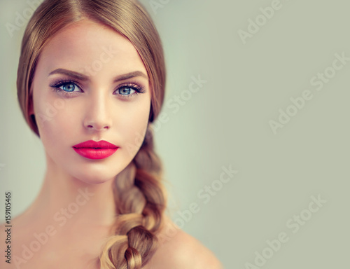 Fotografie, Obraz  Beautiful young woman with braid hair  and red lips