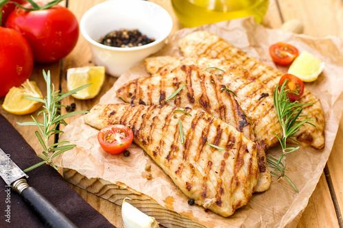 Grilled pork escalopes with rosemary and cherry tomatoes