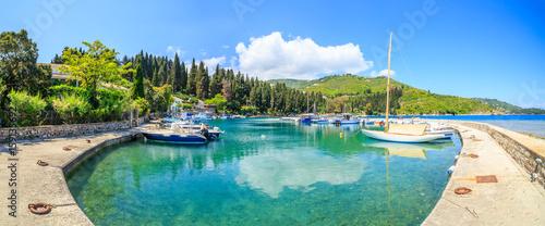 Foto auf Gartenposter Stadt am Wasser Boats in port Kouloura in Corfu, Greece