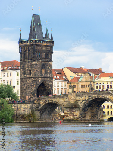 Ingelijste posters Oost Europa prague old town tower at the end of charles bridge and its reflection in vltava river