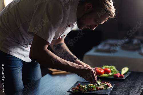 Canvas Prints Cooking Male cook serve delicious steak on the cutting board at street cafe